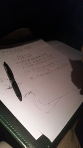 Liam attempting to work out the inverse kinematic equations for the rover's arm on the plane ride to Frankfurt.